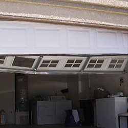 Garage Door Dented Panel Repair